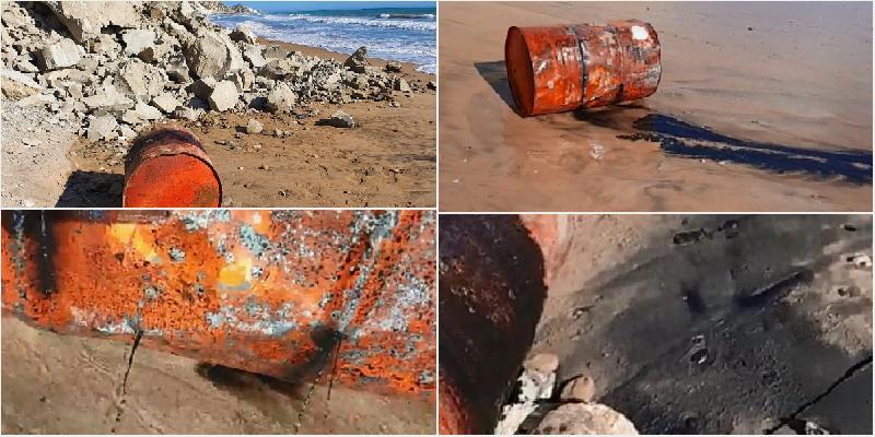 Fusto di olio esausto in spiaggia